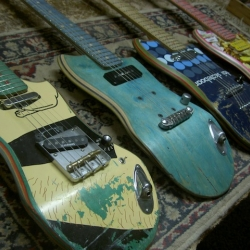 Some pictures and a video of guitars made of shreddered skateboards by Ezequiel Galasso.