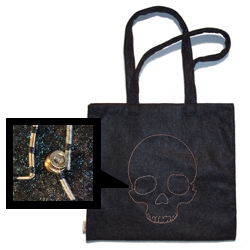 SKULLAVERA: Tote-bag made with Eco-Fi (high-quality polyester fiber made from 100% certified recycled plastic PET bottles). Lined with 100% organic cotton and embroidered with GUITAR STRINGS!!. For all you skull lovers!