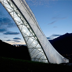 New Olympic Ski Jump in Garmisch-Partenkirchen by german architects terrain: loenhart&mayr. The new structure wrapped with translucent polycarbonate has an amazing view at night.