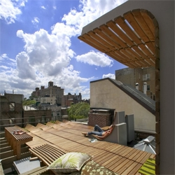 Looking for the perfect summer escape? How about opening a trapdoor to this New York rooftop with built-in lounges and panoramic skyline views?