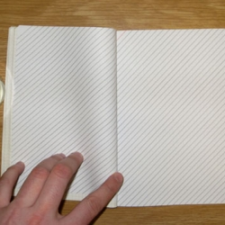 A notebook concept where the lines are at a 45 degree slant, so you don't have to twist your notebook to write when in a tight spot like on a plane.