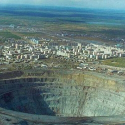 The world's biggest hole! Wouldn't want to fall down that! The giant hole is actually a diamond mine in Eastern Siberia near the town Mirna.  It is 525 meters deep and 1.25 km in the diameter.