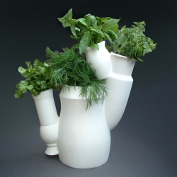 4 different kitchen herbs on your dining table! The individual vases represent different cultures forming something nice together.