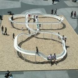 Loop bench by Jeppe Hein activates the urban landscape by combining a slide with public seating. now showing at Art Basel.