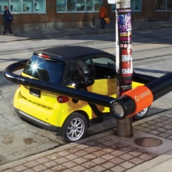 To showcase the smart car's impressive ability to park anywhere in a dense, busy urban environment. BBDO Toronto created an oversized bike lock to exaggerate the smart car's ability to park anywhere.