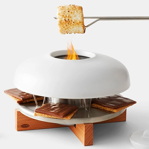 S'mores Roaster from chef'n - Comes with 4 stainless steel roasting sticks, ceramic dome, wire mesh, flue, metal tray, wooden base, and snuffer.