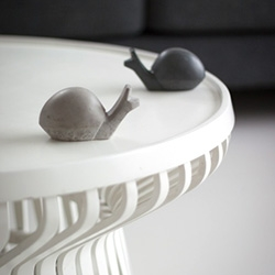 IHANNA concrete snail hooks. They can sit on a table, or be mounted on a wall.