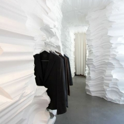 Snarkitecture architecture duo outfitted a temporary retail space as an ice cavern for fashion designer Richard Chai underneath the High Line in New York City.