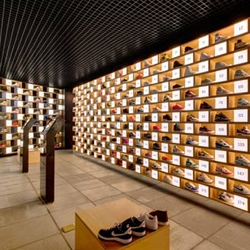 Sneakerology by Facet Studio is a sneaker shop interpreted as a sneaker museum.