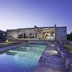 A beautiful concrete house in Argentina, designed by A4studio. The house also includes an office for the owner, with the spaces arranged around a central patio. Lovely pool!