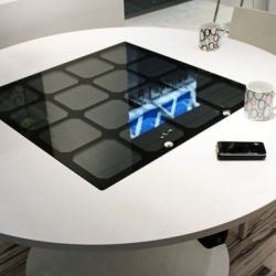 Panasonic's Solar Charging Table makes for neat wireless conductive charging for your phone.
