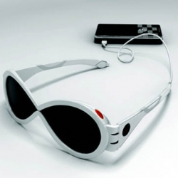 "SIG, or ""Self-Energy Conversion Sunglasses"" are quite simple. The lenses have dye solar cells, collect energy and make it able to power your small device through the outlet in the back of the frame."