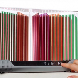 Hélio DAB Radio using colorful Grätzel solar panel that is transparent. LED panels and speakers complement the radio and in sync with the form.