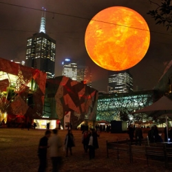 """Rafael Lozano-Hemmer's """"Solar Equation"""" is a large-scale public art installation that consists of a faithful simulation of the Sun, 100 million times smaller than the real thing. Commissioned by the Light in Winter Festival in Melbourne."""