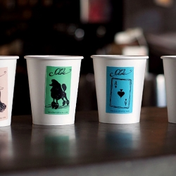 Simplistic art on take away cups. 