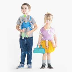 Solly Dolly Wraps - kids get mini strollers for their dolls, so i guess it should be no surprise they can now strap them on just like adults.