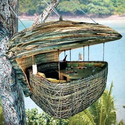 Tree Pod Dining is available at the Soneva Kiri Thailand Resort. The Pod was engineered with a rigid frame swathed in woven rattan with an open panorama window. Food courses arrive courtesy of a flying waiter – harnessed to a zip line –