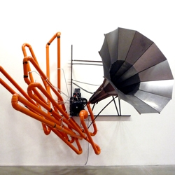 Alberto Tadiello, a former construction worker turned artist, creates sculptures with building materials. Some of his work is kinetic and the sounds that come from the art are reminiscent of a construction site.