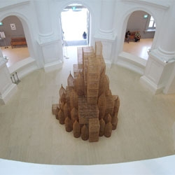 Compound by Cambodian artist Sopheap Pich at Singapore's Art Biennale reflects on development using traditional building materials.