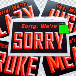 "The ""Yes, We're Sorry We're"" signs from #24187 are back in plastic form: high quality, indestructible, black and day-glo orange, and hand-printed by MPLS own Aesthetic Apparatus."