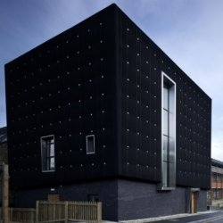 The Soundhouse building at the University of Sheffield is now complete. The building is clad in sound insulating black rubber.