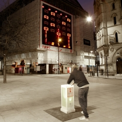 Filthy Luker's Space Invaders, the street artist's retro-arcade installation brings Space Invaders to life with roadwork equipment.