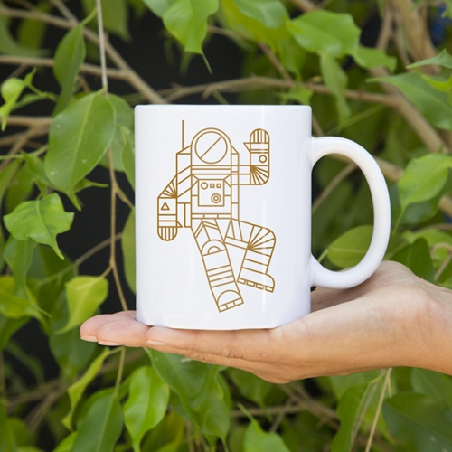 Hello Spaceman mug by Brave the Woods. This friendly geometric astronaut is there to hang with you on your desk, table or wherever you decide to take a sip or stash your pens.