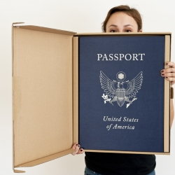 ZERO+ publishing has teamed up with international street artist ABOVE and made a larger than life book titled 'Passport.' The special edition box is an enormous replica of the US passport that houses the book inside.
