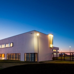 It's not too often that you find nice looking sports centers. This sport center is located on Iceland and was drawn by Arkitektur.is. I really like the white polished walls and the stone pile resting on one of the sides.