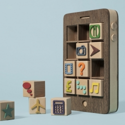 Wooden phone with cube 'apps' made for the latest cover of Computer Arts magazine. A collaboration between Kyle Bean and Thomas Forsyth.