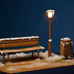A bench baked with gingerbread. Stockholm Stadsmission: An old Christmas tradition is thousands of people celebrating Christmas in homelessness. These cards helps us to break that tradition.