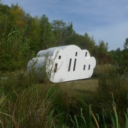 French designers Zébra3/Buy-Sellf have designed a prefabricated holiday home in the shape of a cloud that sits next to a lake in south-west France.