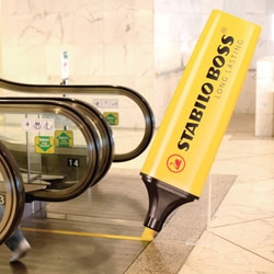 Giant Stabilo pens were installed at the beginning of escalators throughout Hong Kong. As the steps continually moved forwards, the pen appeared to create the bright yellow safety marks on the side of the steps – non-stop from morning to night.