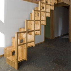 Awkward step-by-step wooden stair, which according to the architects is actually very comfortable.
