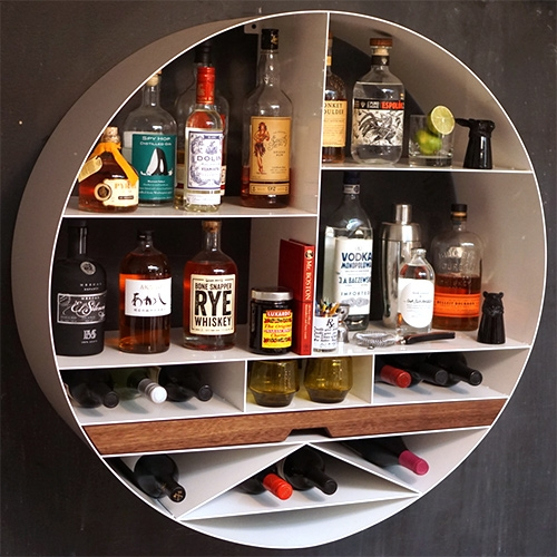 Sean Woolsey's Libation Station is an all around bar storage solution storing up to 45 bottles of your favorite libations made of high grade aluminum.
