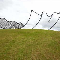 4 story, metal sculpture by neil dawson creates great optical illusion