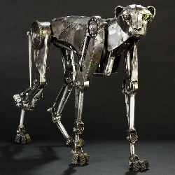 Steampunk Mechanical Cheetah by Andrew Chase is made of electrical conduit, transmission parts, and 20-gauge steel. The cheetah has mechanical joints to allow some movement.