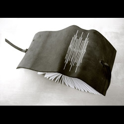 Beautiful hand bound notebooks and journals by Jovencio de la Paz. 100% recycled leather, true book couture.