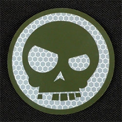Triple Aught Design's reflective skull sticker - just gave in to one for my macbook air - love the subtle hexagon detail of the reflective bits...