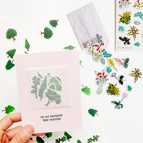 Cute cards and stickers of plants, flowers, and vegan goodies by Common Objects Co.(aka Katrina Tan) that are packaged in lovely little glassine envelopes.