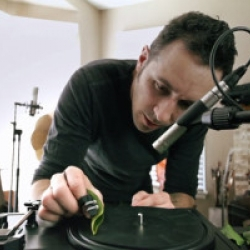 Composer and sound artist, Diego Stocco, experiments with a turntable + leaves. More specifically all bass, kick and snare sounds are made by alternating the leaf type, angle, pressure as it was applied against the turntable.