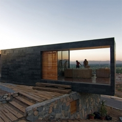 This house by Polidura Talhouk Arquitectos in the chilean countryside blends with the surrounding landscape while generating perfect spaces for overlooking the valley.