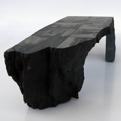 With his work heavily influenced by the industry of processing raw materials, Dutch designer Lex Pott has created a series of unique tables that retain the raw, rugged forms that are created during the extraction process of Belgian bluestone.
