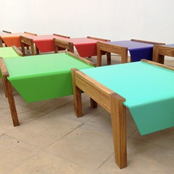 Benchmelade series combining aluminum and woodwork, designed and made by Puerto Rico based María del Mar Gómez and Martín Albarrán.