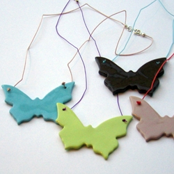Casalinga does some gorgeous work with porcelain, including these butterfly necklaces.