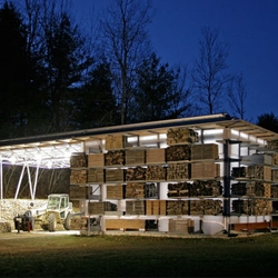 Gray Organschi Architecture, designed a simple barn  structure where the lumber is organized on the exterior of the building, creating a wonderful mosaic-like texture that proves that functionality and aesthetics can go hand-in-hand.