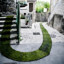 Public artists Gaëlle Villedary helped the French village of Jaujac celebrate the 10th year of its arts and nature trail programs by cutting a new green path through its city center.