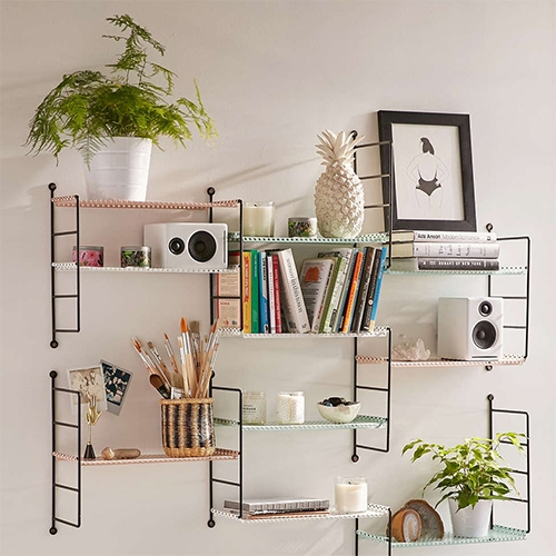 "Urban Outfitters ""Adjustable Perforated Shelf"" system looks like a take on the classic String shelves?"