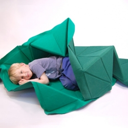 Studio Gorm's construction quilt was designed as simple multifunctional interior piece that can be transformed into a toy by children. It works as a carpet, a couch cover and can be converted into a landscape for toy cars or fort to play in.