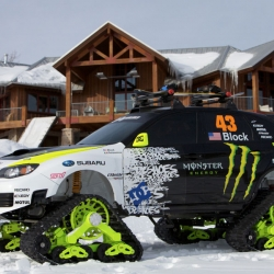 At the SEMA Show this week, Ken Block unveiled the world's fastest snow track automobile, his new 400 hp Subaru TRAX STI. This experimental car is equipped with snow car tracks and a monster suspension.
